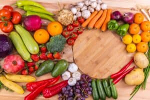To show assorted fruits and vegetables that comprise a Mediterranean cuisine.